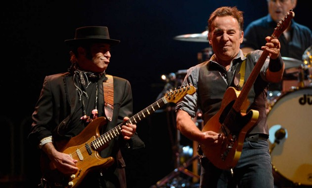 """EAST RUTHERFORD, NJ - SEPTEMBER 19:  Nils Lofgren, Bruce Springsteen, Max Weinberg and The E Street Band perform during the """"Wrecking Ball"""" tour at MetLife Stadium on September 19, 2012 in East Rutherford, New Jersey.  (Photo by Kevin Mazur/WireImage)"""
